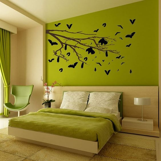 green lime painted wall for fresh and cozy bedroom