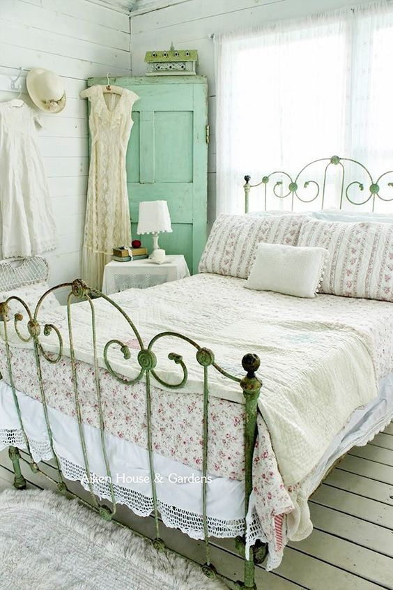 shabby chic bedroom with accent green decoration