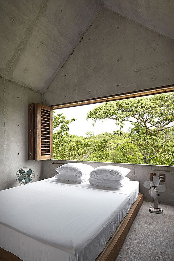 clean and spacious bedroom with natural backdrop