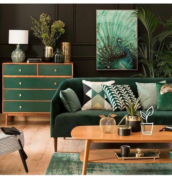 Dark green wall and peacock painting for tropical living room ideas