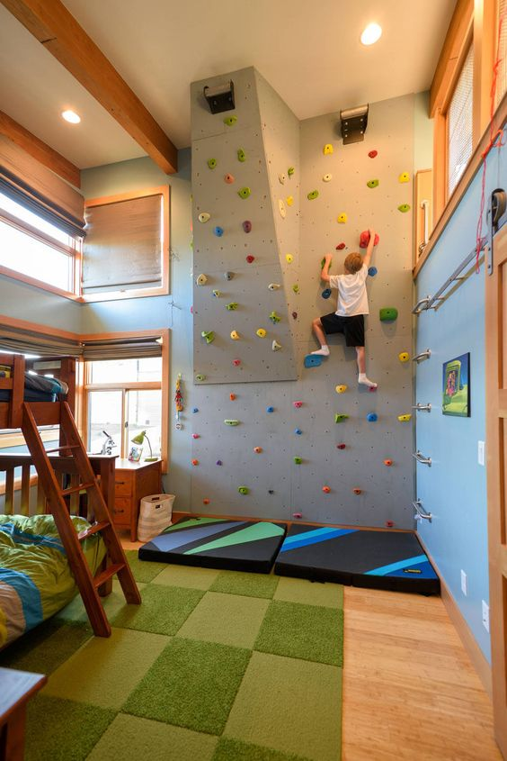 adventurous bedroom with rock climbing wall for kids