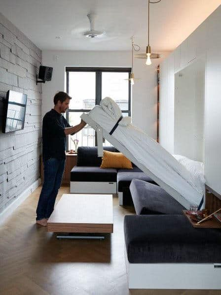 built-in bed to save the space in the Scandinavian studio apartment