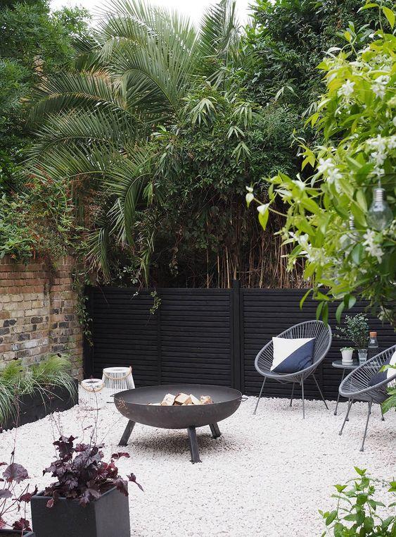 cozy black house backyard style!