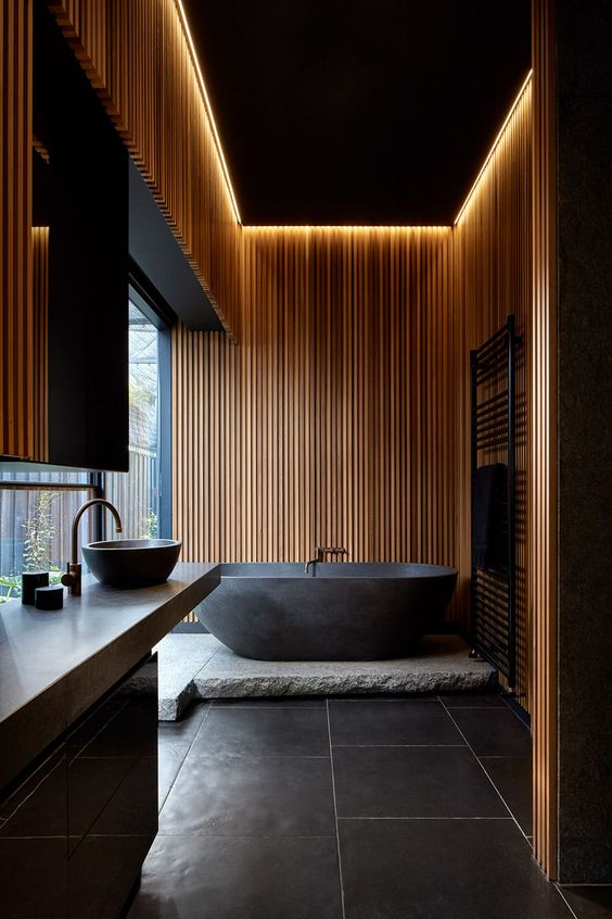 timber wall accent make the bathroom cozy and warm feel