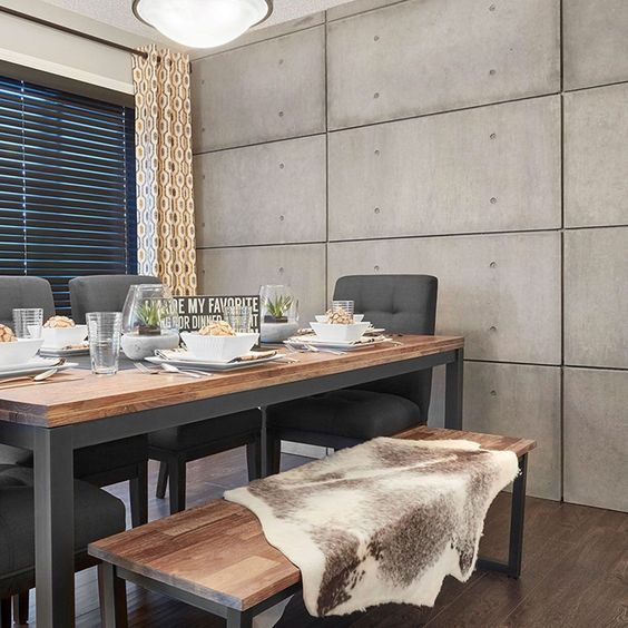 stylish dining area with concrete wall panel