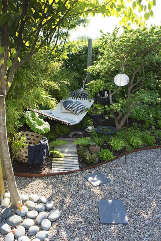 cozy outdoor reading nook by installing hammock in the backyard