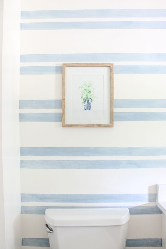 the blue stripe accent wall for a bathroom