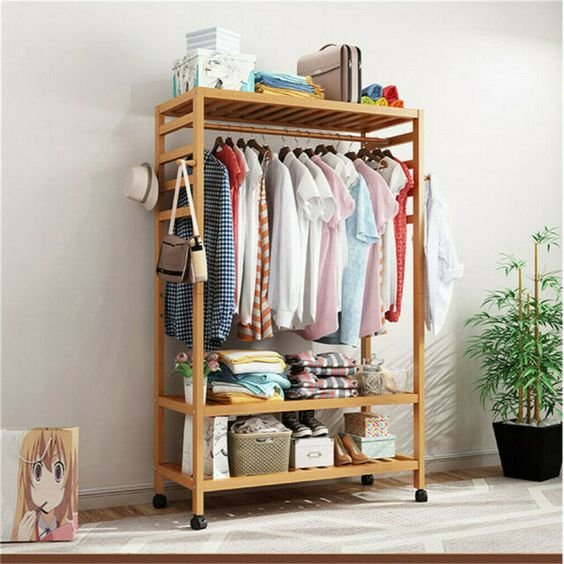 clothes rack to save space in a small bedroom