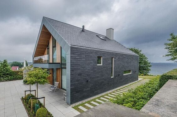 Scandinavian home exterior with cupa stone