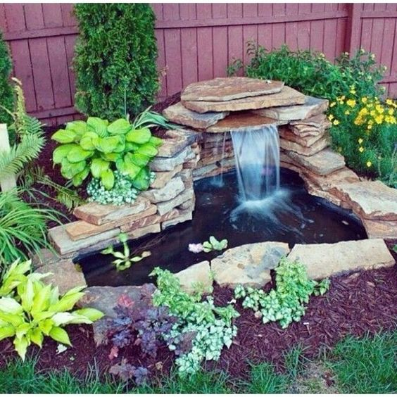 DIY layer bed water feature for a small pond