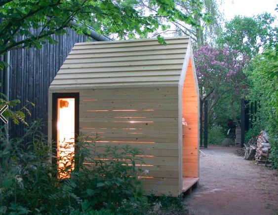 Decorative Scandinavian garden with shed