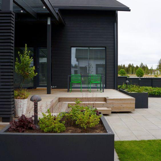 Scandinavian garden ideas with raised bed