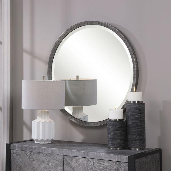 bartow round mirror in masculine bedroom