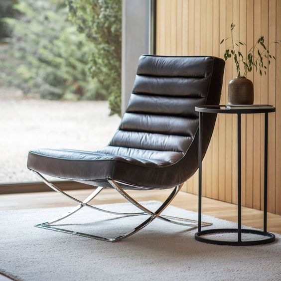 Black leather lounge chair for masculine bedroom decoration