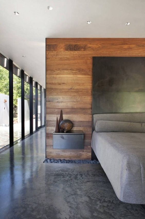 concrete flooring in the masculine bedroom