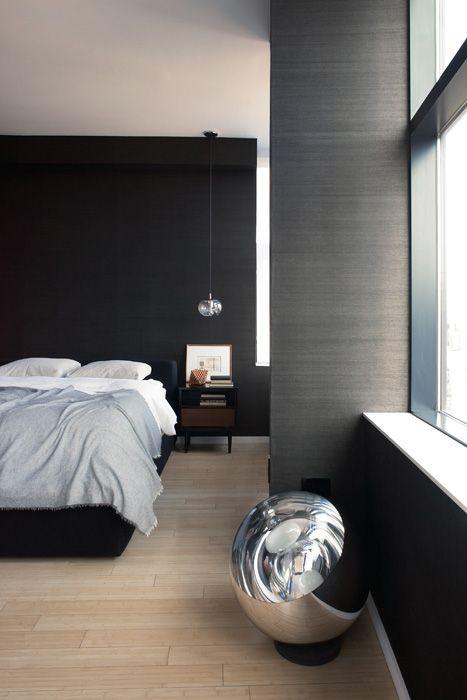 lightwood flooring style in men's bedroom