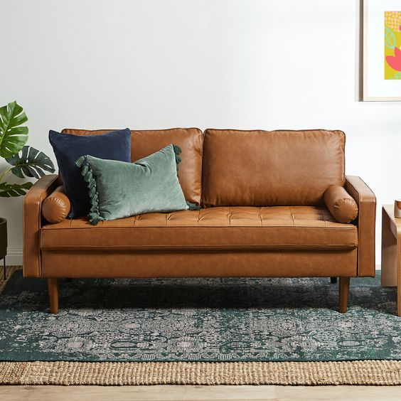 tan faux leather sofa for masculine living room decor
