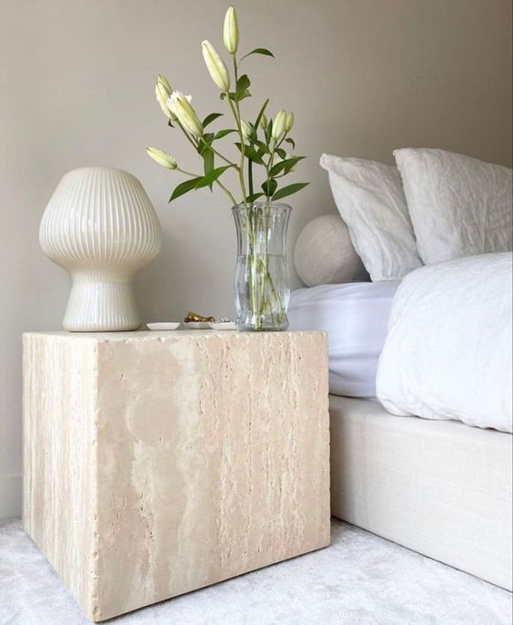 Japandi bedroom decor with organic marble night table